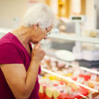 Senior womat supermarket — Stock Photo #21915793