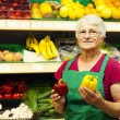 Senior woman at supermarket — Stock Photo #21915827