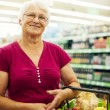 Senior woman at supermarket — Stock Photo #21915845