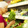 Senior woman at supermarket — Stock Photo #21915849