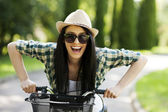 Woman with bicycle — Stock Photo