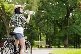 Cyclist drinking mineral water — Stock Photo