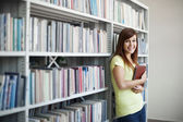 Beautiful student in library — Stock Photo