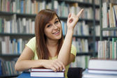 Student pointing at copyspac — Stock Photo