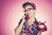Happy pin up girl talking on retro telephone — Stock Photo