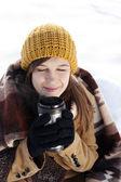 Woman drinking hot drink — Stockfoto