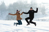 Young couple jumping — Stock Photo