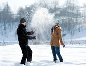 Young couple playing with snow — Stock Photo