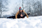 Young couple sledding on snow — Stock Photo
