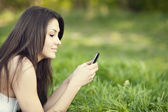 Young woman texting — Stock Photo