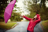 Young woman with pink umbrella — Foto de Stock