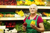 Senior woman at supermarket — Stock Photo