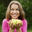 Royalty-Free Stock Photo: Young woman with grapes
