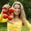 Woman with tomatoes — Stock Photo #21961319