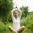 Yong woman practising yoga — Stock Photo