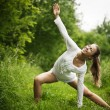 Stock Photo: Yong woman practising yoga