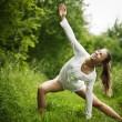 Yong woman practising yoga — Stock Photo