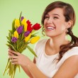 Laughing woman with tulips — Stock Photo #21962663