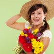 Smiling brunet woman with hat and spring flower — Stock Photo