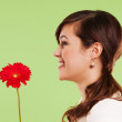 Pretty woman holding red flower — Stock Photo