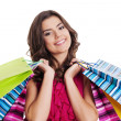 Stock Photo: Happy woman holding multi colored shopping bags