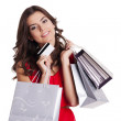 Young woman with credit card and shopping bags — Stock Photo