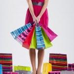 Fashion woman holding shopping bag — Stock Photo