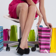 Sitting woman checks her shopping — Foto de Stock
