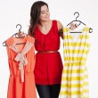 Woman choosing a new dress — Stock Photo