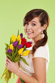 Portrait of a young woman with spring flowers — Stock Photo