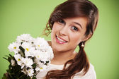 Attractive young woman with white daisies — Stock Photo