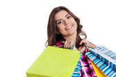 Brunette woman with multi colored shopping bags — Stock Photo