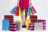 Woman with full shopping bags — Stok fotoğraf