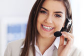 Happy female wearing headset — Foto de Stock