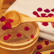 Stock Photo: Rose petal on wooden spoon