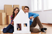 Young couple with house signs — Stock Photo