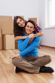 Happy couple in their new house — Stock Photo
