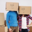 Couple with boxes - Stock Photo