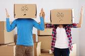Couple with boxes — Stock Photo