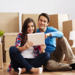 Couple unpacking their stuff - Stock Photo