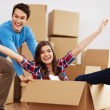 Couple having fun in new home — Stock Photo #24074097