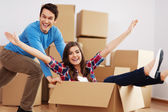 Couple having fun in new home — Stock Photo