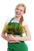 Happy gardener female with her plant — Stock Photo