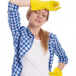 Tired woman wearing a protective glov - 