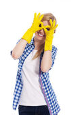 Cheerful woman with protective glove making hand gesture — Stock Photo