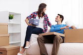 Loving couple unpacking in their new home — Stock Photo