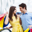 Happy young couple shopping - Stock Photo