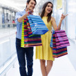 Stock Photo: Happy young couple shopping