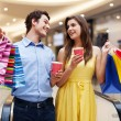 Happy young couple shopping — Stock Photo #25020021