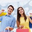 Happy young couple shopping — Stock Photo #25020069